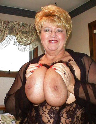 old mom squeezing her monster tits