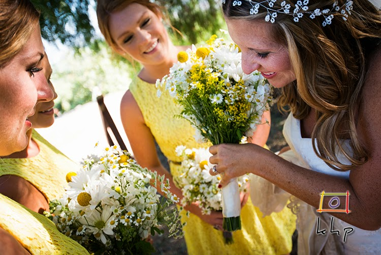 Kristyn shows of her ring to her bridesmaids in the lemon orchard at The Limoneira Ranch