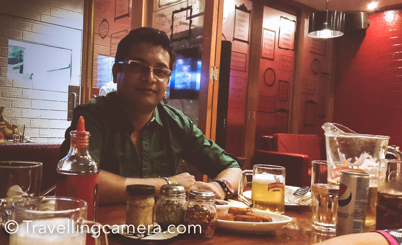 Before I start sharing about the place, please accept my apologies for bad quality photographs on a Photography blog. This month we were in Kolkata for few days and it was a good opportunity to catch up with friends in the city. During 4 days of our stay in Kolkata, we visited different restaurants and pubs and found Mezzuna quite interesting and that's why thought of writing about this place here.Place is in Forum Mall of Elgin area in Kolkata. Our local friend Roy  chose this place and it was at walking distance from our place. While writing about this place that I clicked photographs of smoking room as compared to the bar and seating area :) .Mezzuna has great ambiance. btw, you need to wait for few moments to get a table during evenings. Please be aware that they play loud music. Initially I found it irritating because we were there to chat with our friend, but after few drinks everything was fine. btw, they have great variety of mocktails and cocktails.We ordered few starters with drinks and all of them were awesome, although quality of each dish is very small and costs are also bit high. With limited drinks and reasonable food, 3 of us ended up spending approximately 4600 Rs. This was definitely lot expensive than various good options around Park Street. A day before we had dinner at Moulin RougeBeer was still reasonable as compared to other drinks and snacks. Having said that food was very good. So if you are there for good food and beer, it's a great place.  If you are more interested in whisky, vodka or other cocktails, I am sure you would find lot better places around Park Street (in terms of price) .We had great time at Mezzuna and now that I know the place well, I would want to visit it again.
