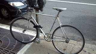 bottecchia bicycle locked to a parking meter