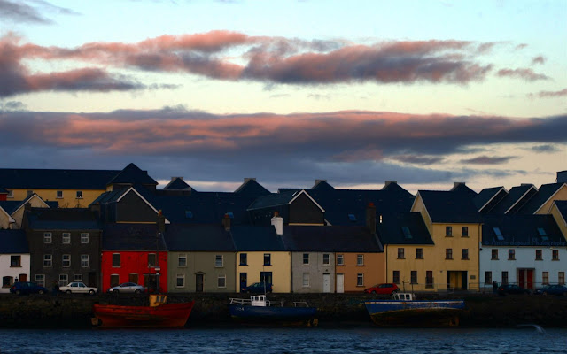 GALWAY CITY, Sunset walk on Claddagh Quay, houses and boats along the quay