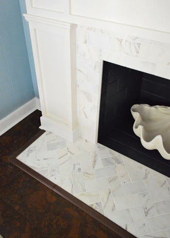 Chic meets healthy fireplace hearth pt 1 herringbone marble tile when young house love posted their fireplace makeover i instantly pinned it to my pinterest board i loved the herringbone pattern and the marble subway tyukafo