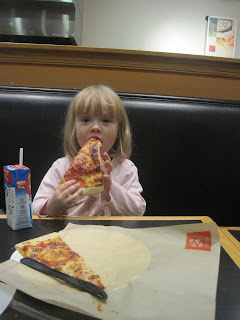Small girl with slice of pizza