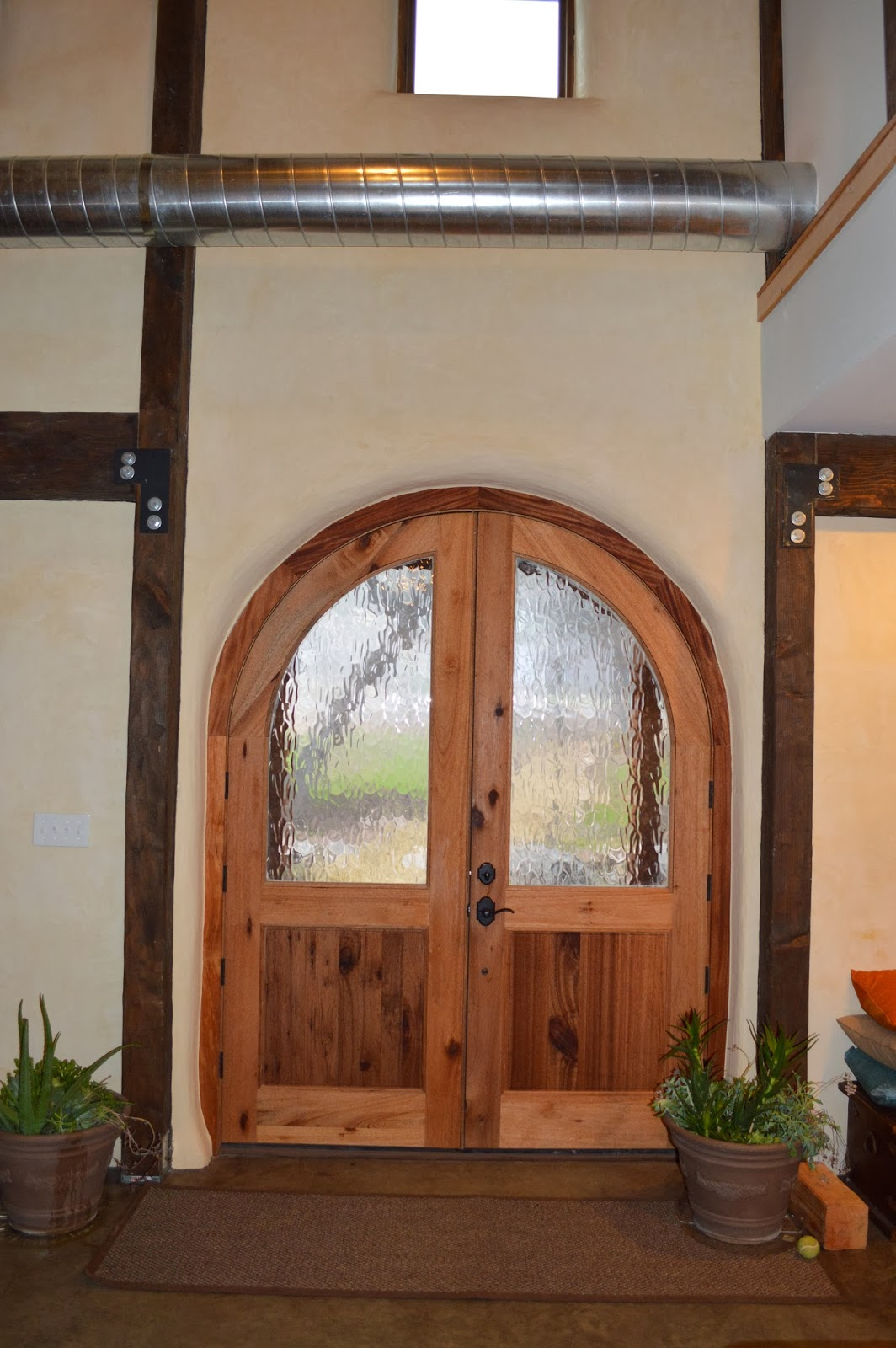 1600 #6C3D24 Strawbale Home Austin TX: It's Finished…Finally! pic Front Doors Austin Tx 38911064