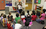 Reading to children at Inlet View Elementary