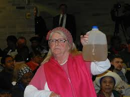 <h2>Flint Resident Upholds Lead Filled Water At Meeting<h2>