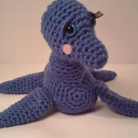 http://www.ravelry.com/patterns/library/amelia-plesiosaur-stuffed-loch-ness-monster-amipal
