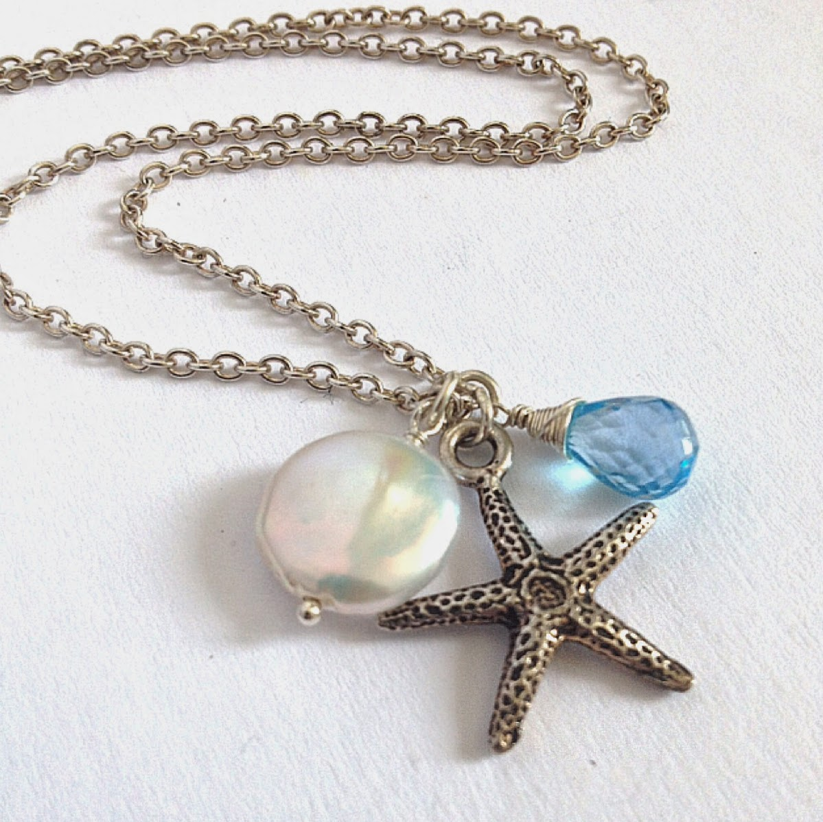 https://www.etsy.com/listing/188591663/starfish-pearl-swiss-blue-topaz-necklace