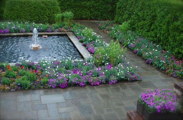 LLongwood Gardens: View down to the Sunken Garden with vibrant border plantings.