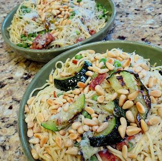 fresh pasta, zucchini, peas, pine nuts