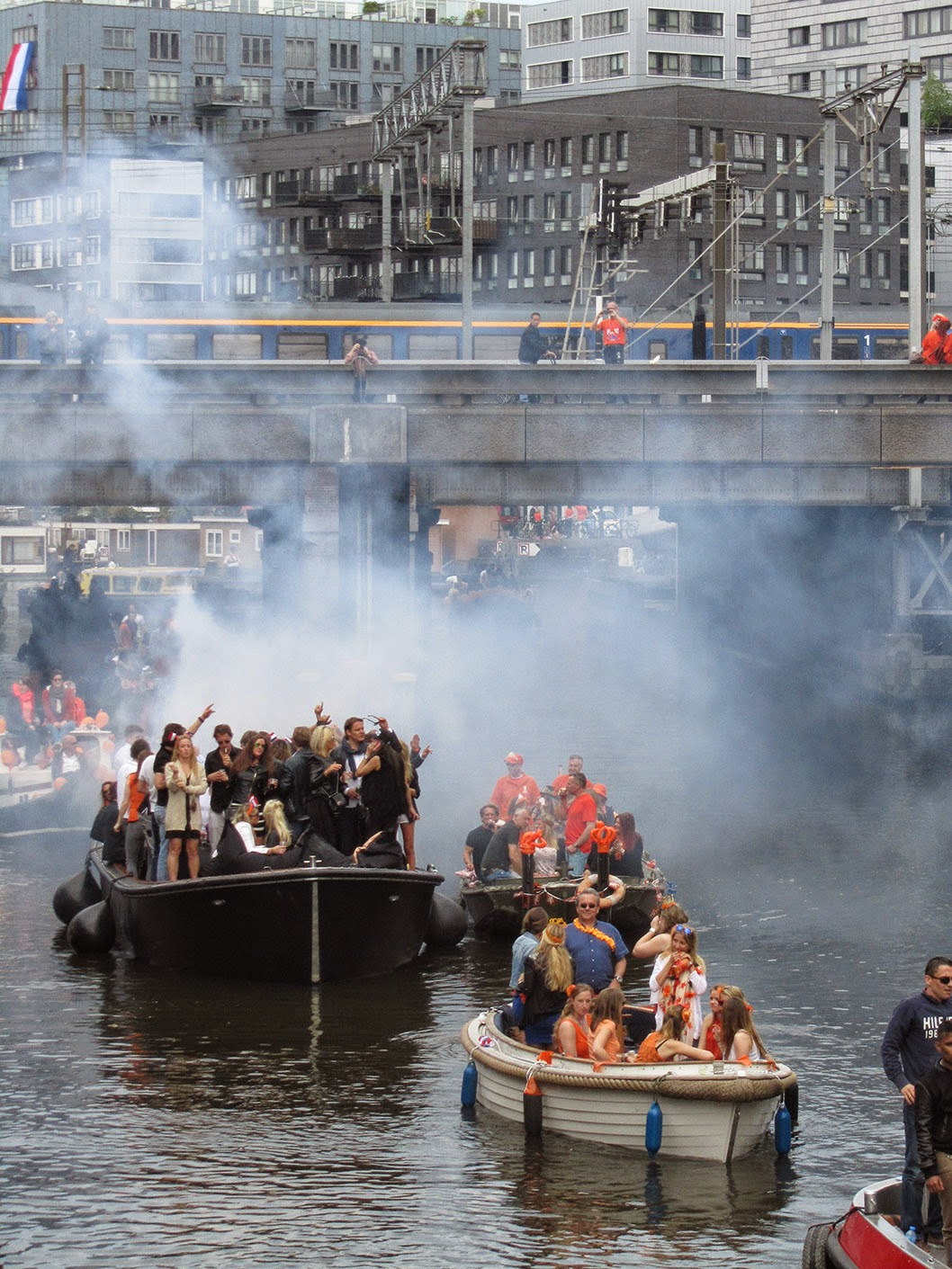 boats on the canal with smoke