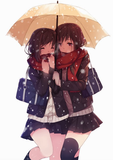 Two girls walking under an umbrella