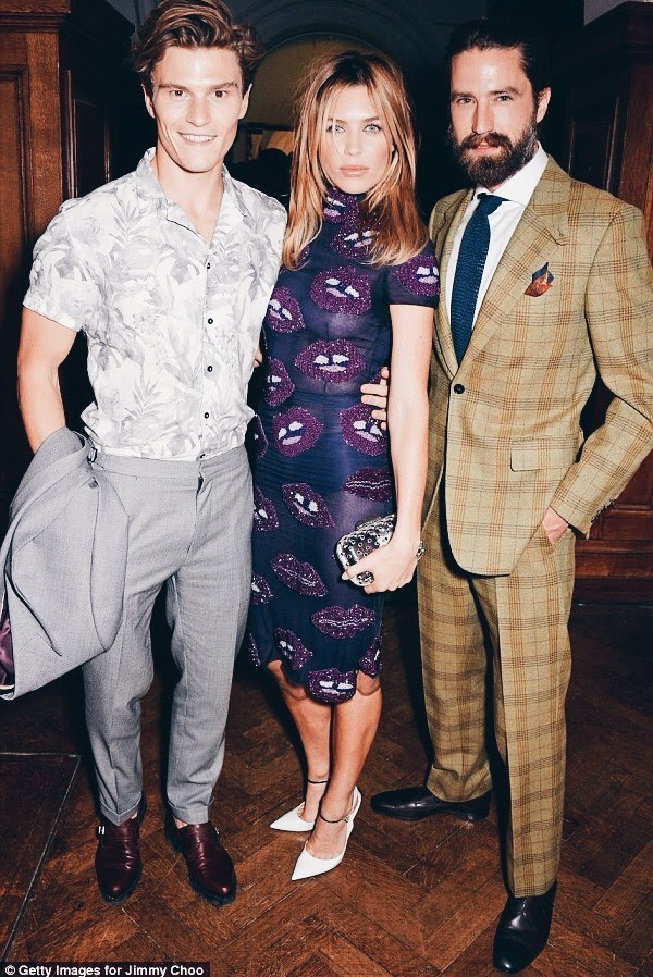 Oliver Cheshire Zara shirt Reiss suit Jimmy Choo shoes - Abbey Clancy Giles Decon lips purple dress - Jack Guinness brown checked Huntsman suit London Collections Men SS2015.JPG