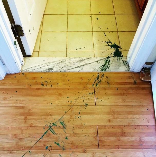Green nail polish bottle, shattered and splattered!