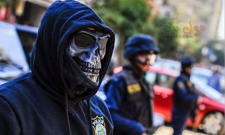 صور ضابط القوات الخاصة المقنع بقناع الجمجمه بشارع فيصل 28 نوفمبر