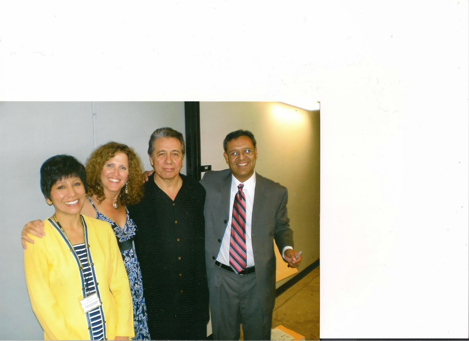 Mom (wearing yellow) and friends with Edward James Olmos