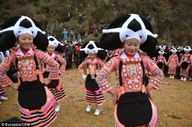 Miao ladies in a function wearing Hair Dress made from their dead ancestors