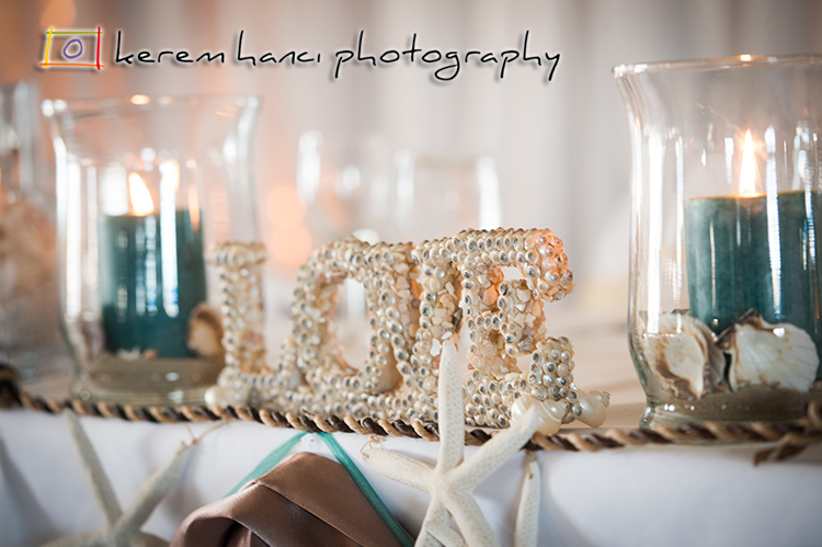 A lovely setup filled with items from the ocean and candles everywhere