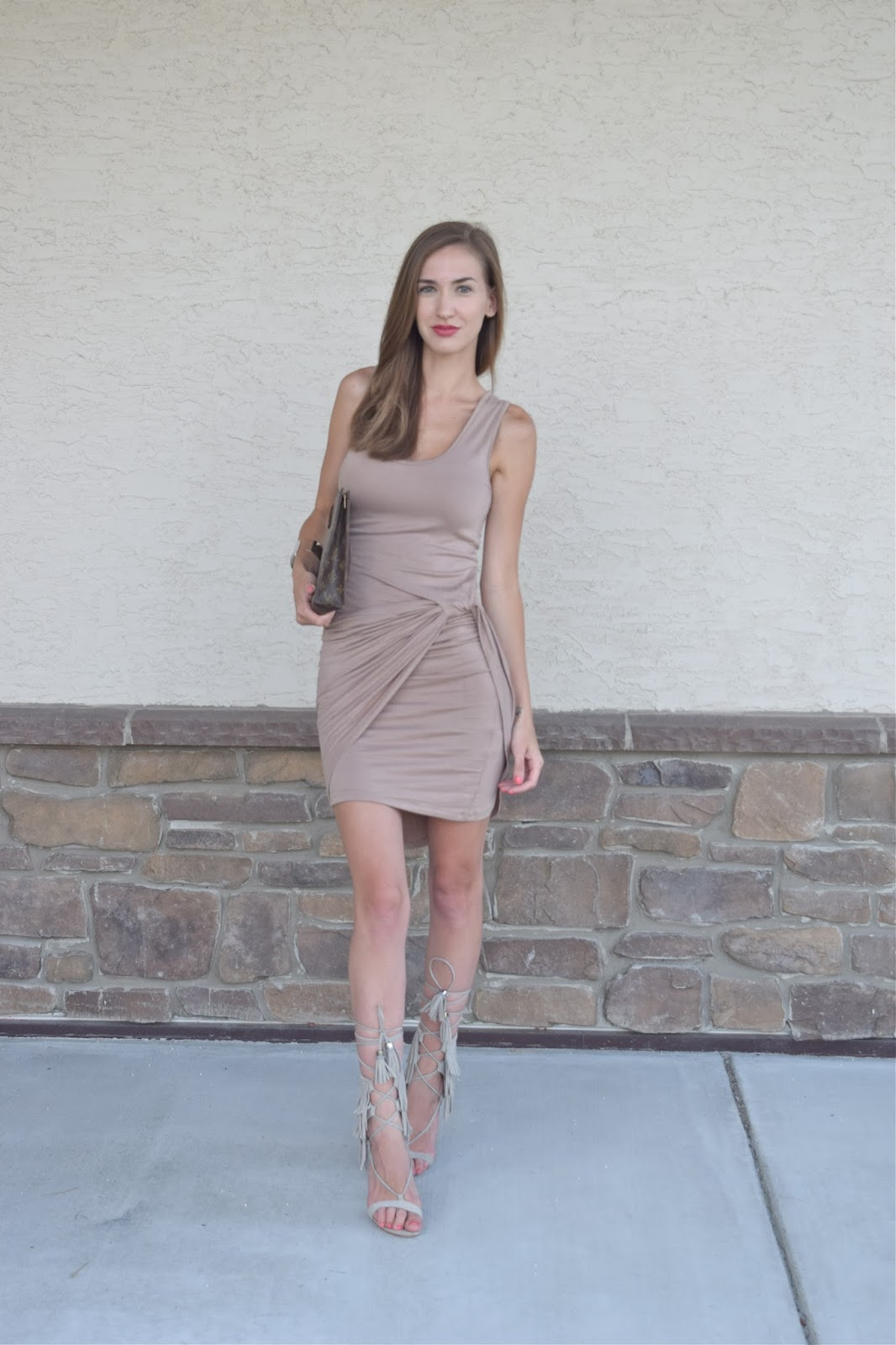 Wearing a wrap tank top dress, wearing Schutz Kija Fringe Heels in Ciment
