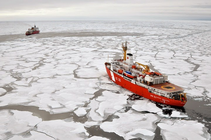 A Canadian and U.S. Coast Guard icebreaker rendezvous in the Arctic Ocean. (Credit: U.S. Geological Survey/flickr) Click to Enlarge.