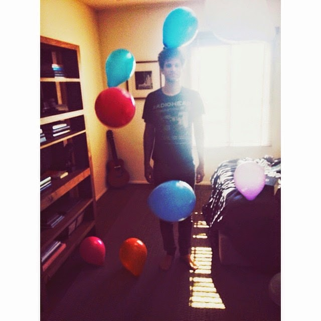 Keegan Allen with birthday balloons
