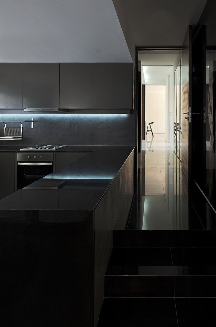 Black kitchen in Modern mansion in Singapore