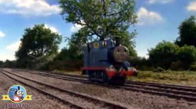 Traveling down the countryside railway track little blue Thomas engine heard the warning horn noise