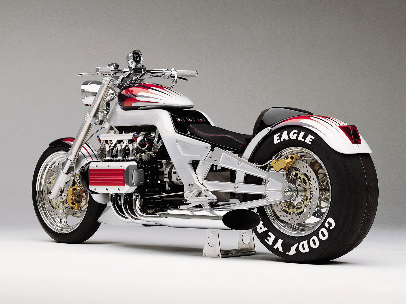 http://3.bp.blogspot.com/-5eYLhpSzgUE/TiUJG7ujKiI/AAAAAAAAAJM/MtXTQWIZuII/s1600/honda_T4_Concept_2000_motorcycle-desktop-wallpaper_03.jpg