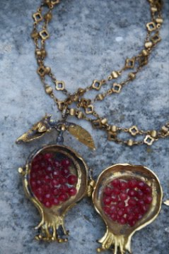 "Pomegranate...filled with garnet ""seeds""."