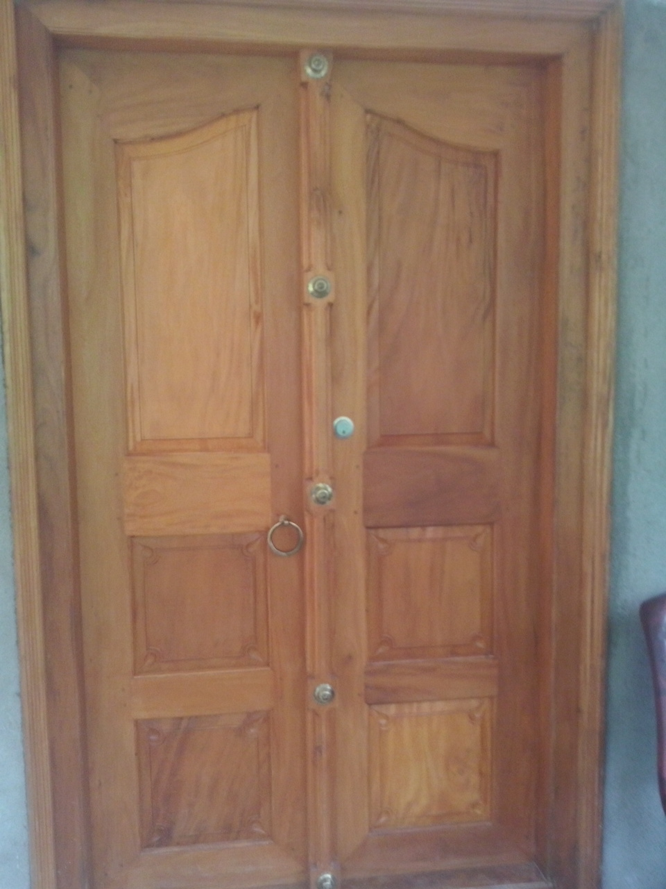 Kerala style carpenter works and designs kerala style for Plain main door designs