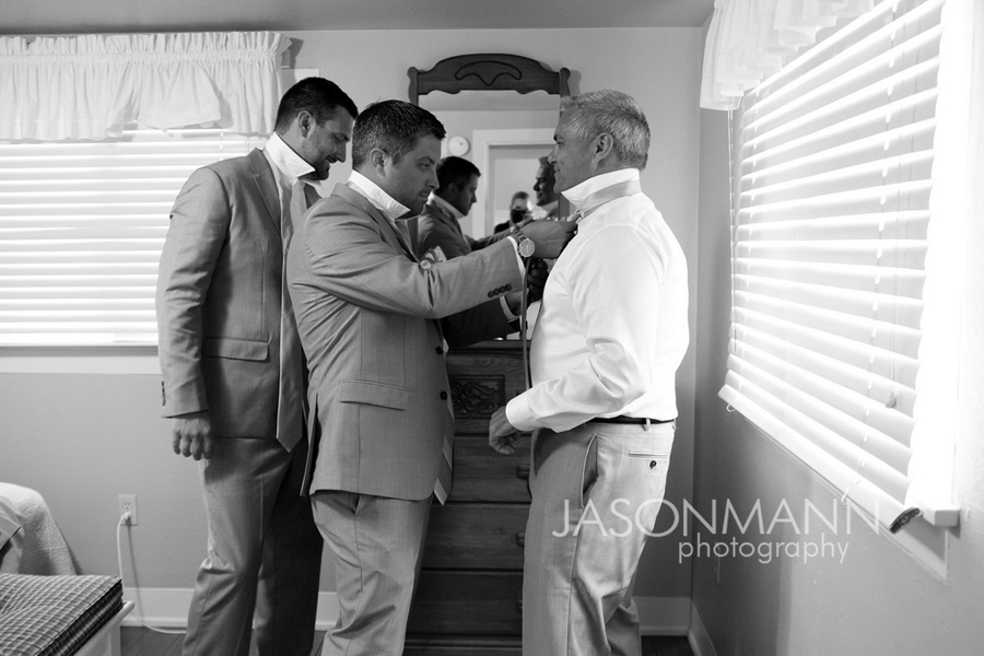 Groom and groomsmen getting ready. Door County wedding. Photo by Jason Mann Photography, 920-246-8106, www.jmannphoto.com
