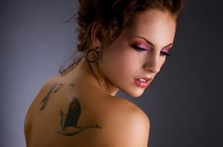 Tattooed Lady with Swan Bird Tattoo on Upper back