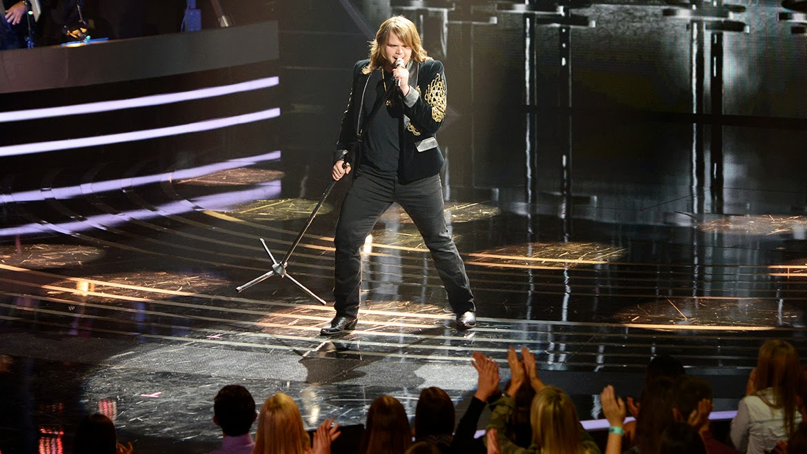 Caleb Johnson performing with the Top 13