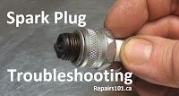 examining a fouled spark plug