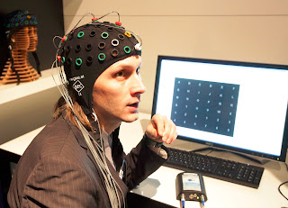 Image of a person using a Noninvasive BCI system