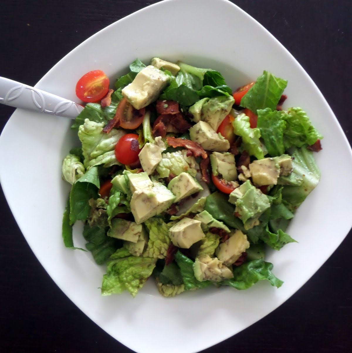 Avocado B.L.T. Salad: Crisp green lettuce tossed in balsamic vinaigrette and topped with crispy bacon, juicy tomatoes, and creamy avocado.