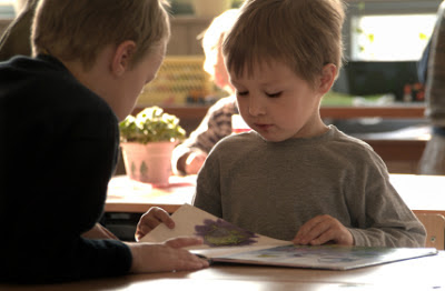 NAMC choosing a montessori school for your child children reading together