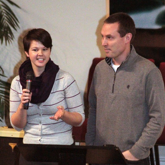 Jake and Dani speaking at a church