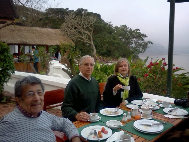 Ted & Dianne with our travel companion Fred at the breakfast terrace overlooking the Mekong River. Foggy early mornings.