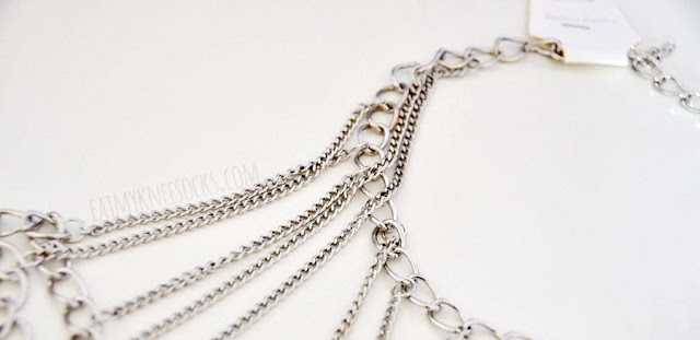 Close-up of the silver layered shoulder chain harness from Born Pretty Store, an edgy accessory.