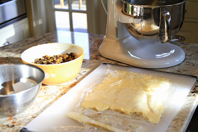 Pounding the butter to plasticize and incorporate more easily into the dough