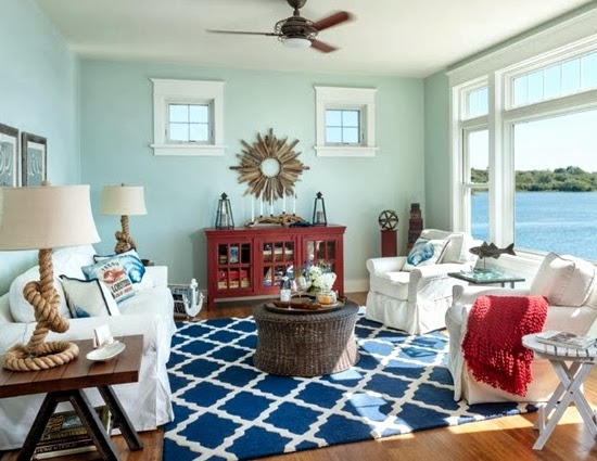 A Casual Living Room With Lots Of Nautical Decorations To