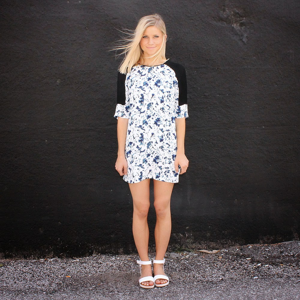 http://www.swankboutiqueonline.com/porcelain-sheen-tunic-dress/