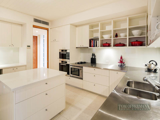 Photo of modern kitchen furniture in waterfront villa