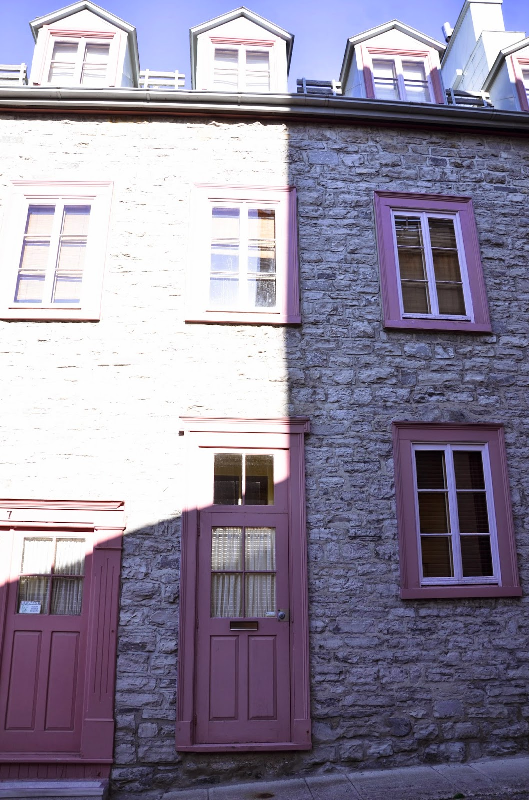 Pink trim on gray brickwork in Quebec City weekend getaway