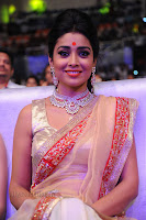 Shriya Saran Stunning Makeup lovely Designer Saree at a TV Channel Launch Function