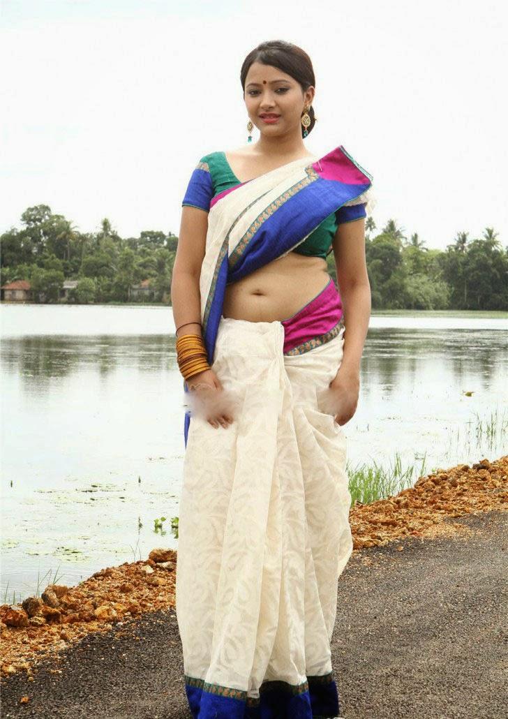 Swetha Basu Prasad Hot Saree Side Navel Show