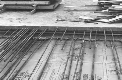 Clay sheets installed under horizontal concrete slab; note the waterstop installed in the cold joint.