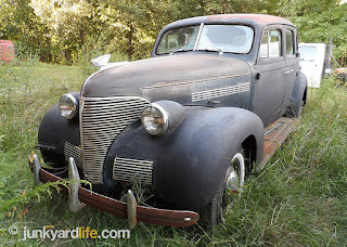 Classic 1939 Chevy behind barn in Tennessee, original with 590 miles on odometer.