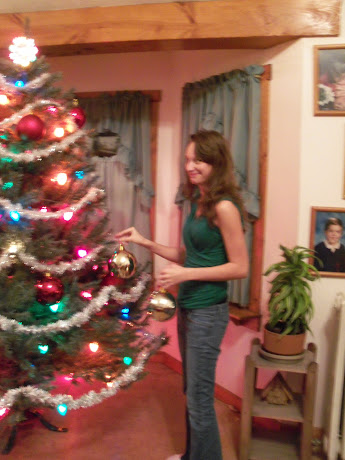 Brittany helps with the ornament
